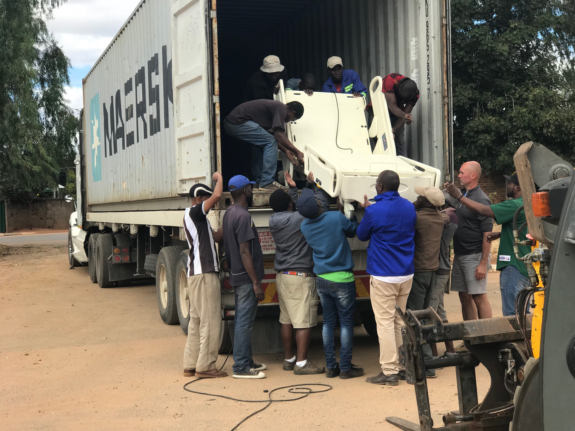 MATTER team unloading hospital equipment in Zimbabwe